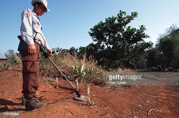De-miner from the Cambodian Mine Action Center uses a detector to look for mines. Millions of anti-personnel mines still litter the Cambodian...