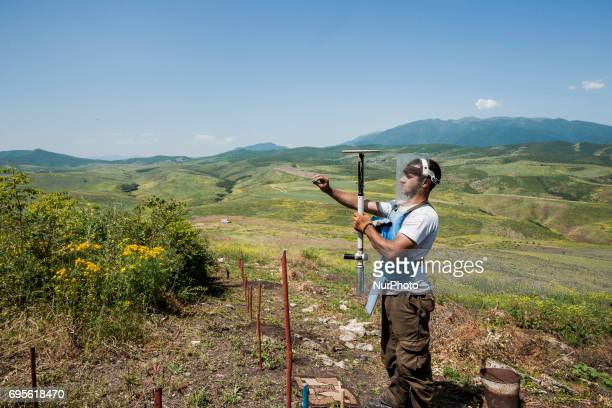 Deminer of HALO Trust organisation calibrates his metal detector in the hills of Nagorno Karabakh, on 13 June 2017. Mines still remain after 25 years...
