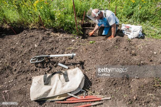 Deminer of HALO Trust organisation digs searching landmines in the hills of Nagorno Karabakh, on 13 June 2017. Mines still remain after 25 years...
