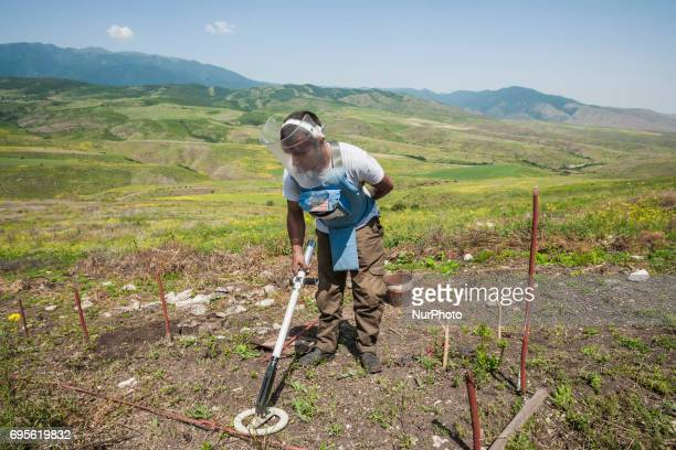 Deminer of HALO Trust organisation searches for landmines with his metal detector in the hills of Nagorno Karabakh, on 13 June 2017. Mines still...