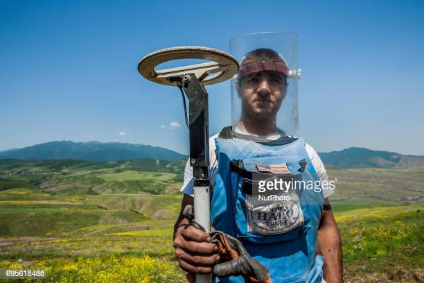 Deminer of HALO Trust organisation with his metal detector in the hills of Nagorno Karabakh, on 13 June 2017. Mines still remain after 25 years since...