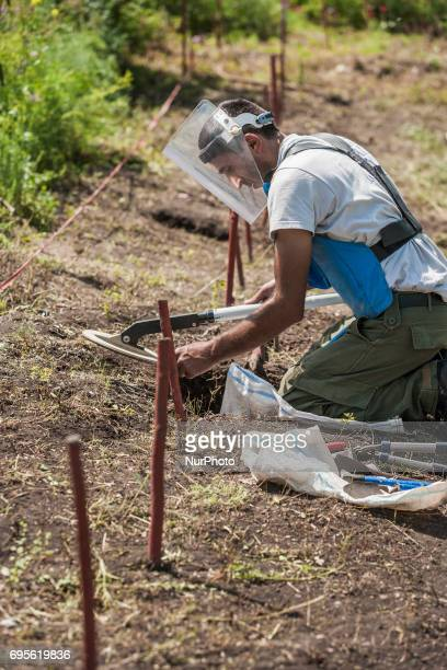 Deminers of HALO Trust organisation searching for landmines with his metal detector in the hills of Nagorno Karabakh, on 13 June 2017. Mines still...