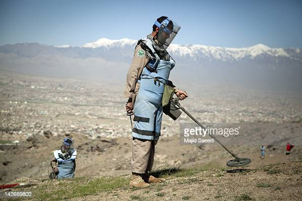 Demining engineers search for mines across a hillside on April 07, 2012 to the south of Kabul, Afghanistan. Afghanistan's mine problem results from a...