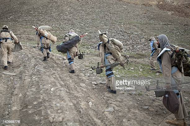 Demining engineers set out to search for mines across a hillside on April 07, 2012 to the south of Kabul, Afghanistan. Afghanistan's mine problem...