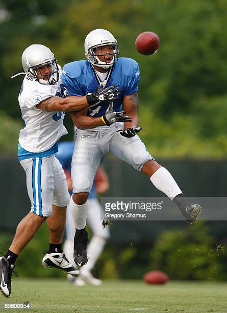 Demir Boldin of the Detroit Lions tries to catch a pass in front of Chris Roberson during training camp at the Detroit Lions Headquarters and...