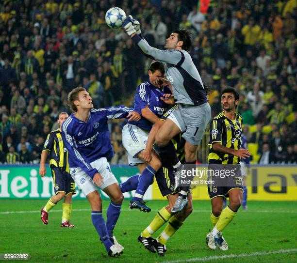 Demirel Volkan the Fenerbahce goalkeeper clears from Ebbe Sand and Soren Larsen of Schalke during the Uefa Champions League Group E match between...