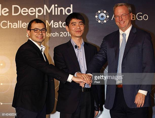 Demis Hassabis CEO of Google's artificial intelligence startup DeepMind South Korean professional Go player Lee Sedol and Google CEO Eric Schmidt...