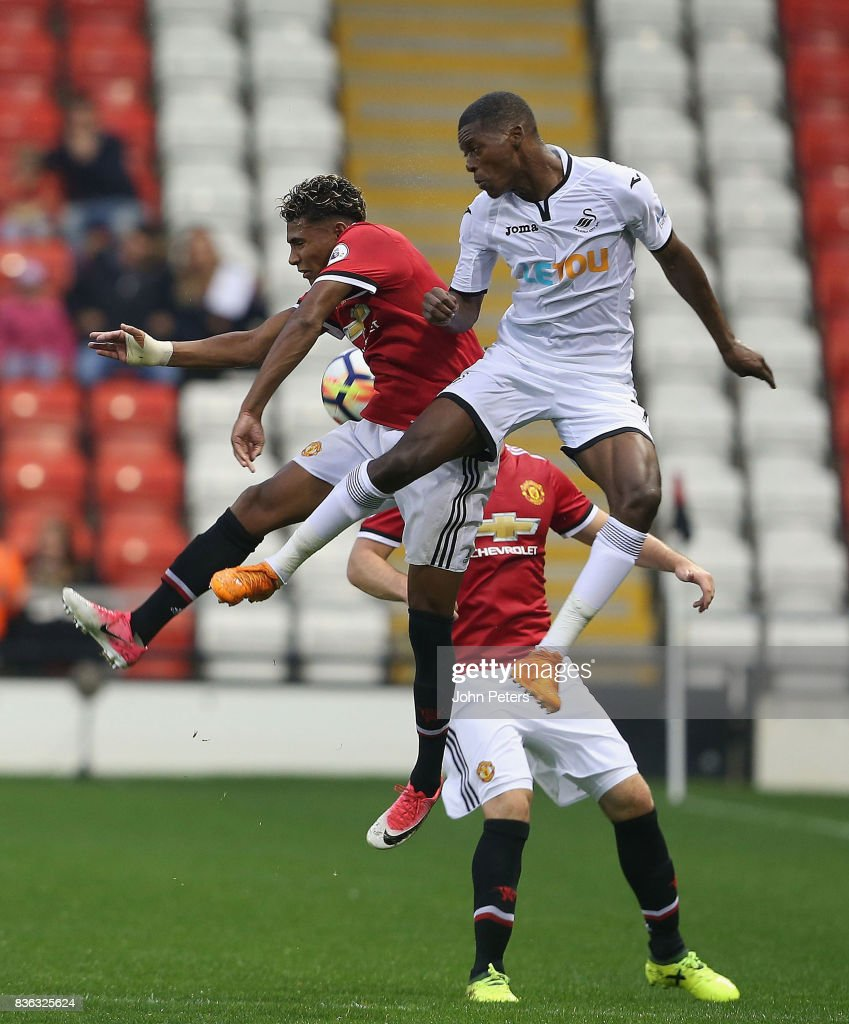 Demitri Mitchell of Manchester United U23s in action with Jordan Garrick of Swansea City during the Premier League 2 match between Manchester United U23s and Swansea City U23s at Leigh Sports Village on August 21, 2017 in Leigh, Greater Manchester.