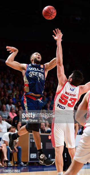 Demitrius Conger of the Adelaide 36ers rebounds over Damian Martin of the Perth Wildcats during the round 14 NBL match between the Adelaide 36ers and...