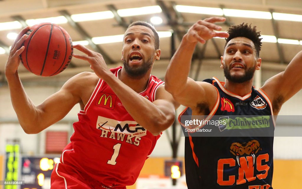 Demitrius Conger of the Hawks and Tevin Jackson of the Taipans compete for the ball during the 2017 NBL Blitz pre-season match between the Cairns Taipans and the Illawarra Hawks at Traralgon Basketball Centre on September 9, 2017 in Traralgon, Australia.