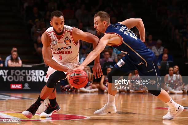 Demitrius Conger of the Hawks controls the ball against Anthony Drmic of the 36ers during the round six NBL match between the Adelaide 36ers and the...