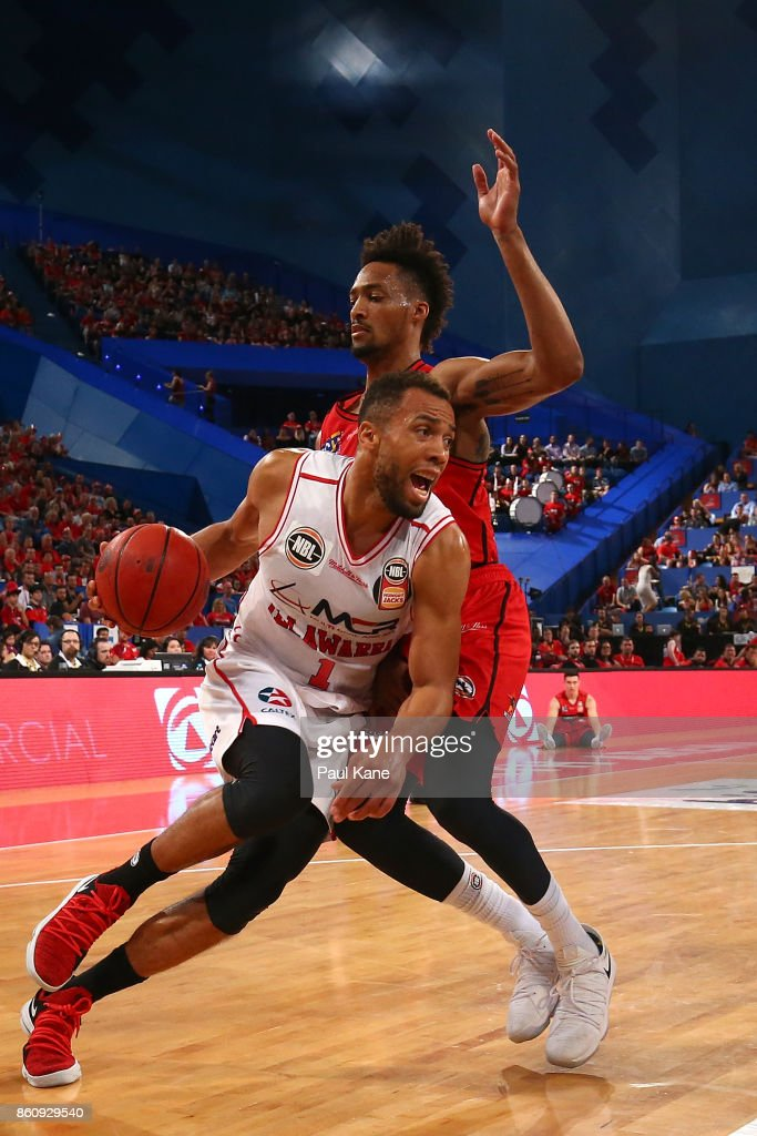Demitrius Conger of the Hawks drives to the basket against Jean-Pierre Tokoto of the Wildcats during the round two NBL match between the Perth Wildcats and the Illawarra Hawks at Perth Arena on October 13, 2017 in Perth, Australia.