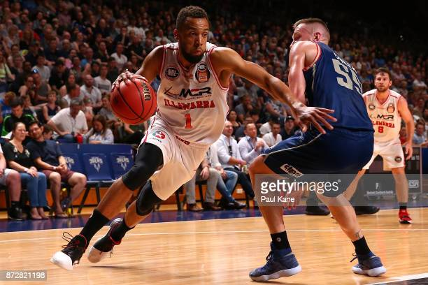 Demitrius Conger of the Hawks drives to the keyway against Mitchell Creek of the 36ers during the round six NBL match between the Adelaide 36ers and...