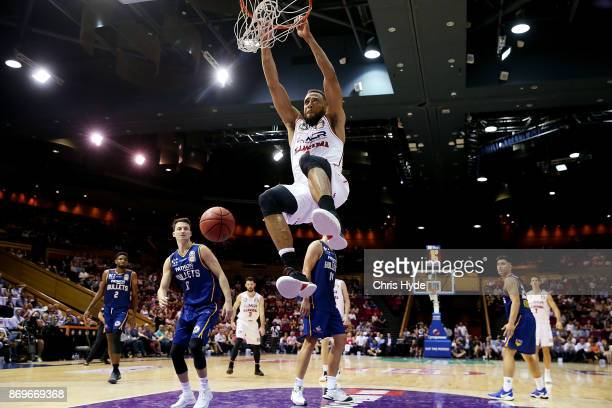 Demitrius Conger of the Hawks dunks during the round five NBL match between the Brisbane Bullets and the Illawarra Hawks at Brisbane Convention...