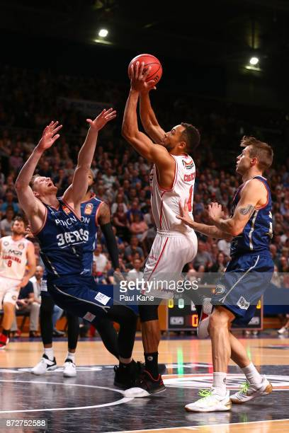 Demitrius Conger of the Hawks fouls Matthew Hodgson of the 36ers going to the basket during the round six NBL match between the Adelaide 36ers and...