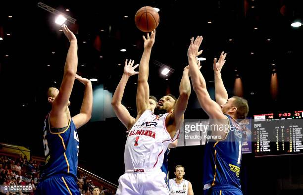 Demitrius Conger of the Hawks is surrounded by the Bullets defence during the round 18 NBL match between the Brisbane Bullets and the Illawarra Hawks...