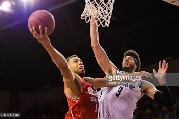 Demitrius Conger of the Hawks lays up a shot under pressure during the round 13 NBL match between the Illawarra Hawks and Melbourne United at...