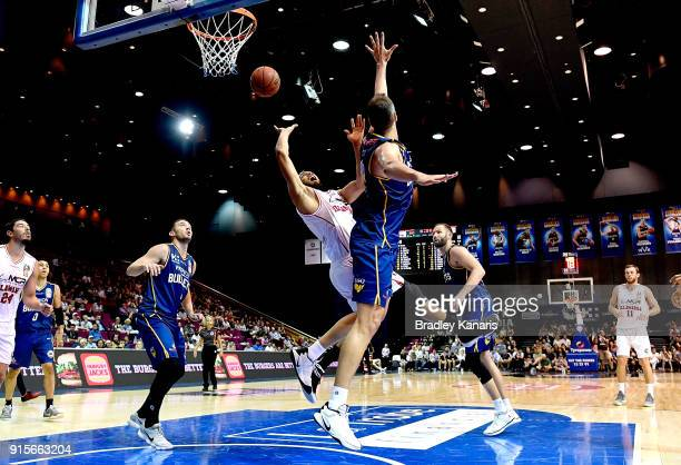 Demitrius Conger of the Hawks takes on the defence during the round 18 NBL match between the Brisbane Bullets and the Illawarra Hawks at Brisbane...