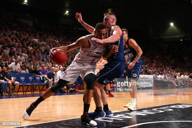 Demitrius Conger of the Hawks works to the basket against Mitchell Creek of the 36ers during the round six NBL match between the Adelaide 36ers and...