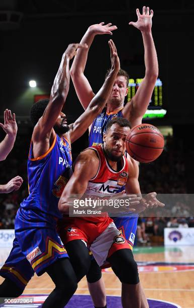 Demitrius Conger of the Illawarra Hawks under 36er pressure during the round 15 NBL match between the Adelaide 36ers and the Illawarra Hawks at...