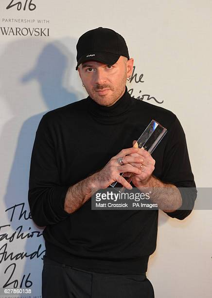 Demna Gvasalia and his award for International Ready To Wear Designer in the press room during The Fashion Awards 2016 at the Royal Albert Hall London