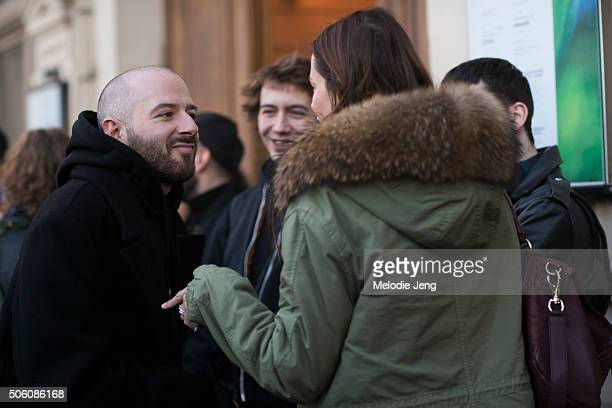 Demna Gvasalia Vetements head designer and Balenciaga artistic director exits the Gosha Rubchinskiy show in a black Vetements hoodie and jacket on...