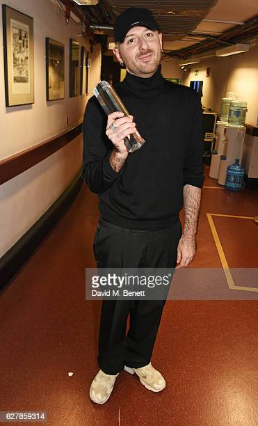 Demna Gvasalia winner of the International Urban Luxury award poses backstage at The Fashion Awards 2016 at Royal Albert Hall on December 5 2016 in...