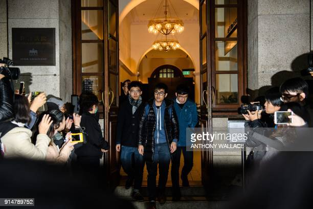 Democracy activists Joshua Wong Alex Chow and Nathan Law meet the media outside the Court of Final Appeal after walking free in an appeal victory in...