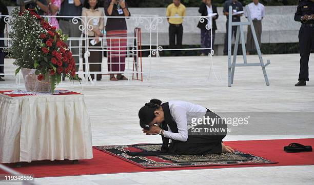Democracy icon Aung San Suu Kyi bows to pray and pay her respects to her father the late General Aung San and eight other leaders who were...