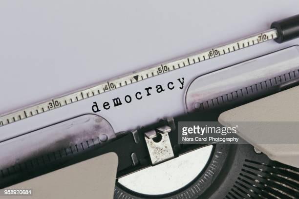 democracy typed on vintage typewriter - 民主主義 ストックフォトと画像