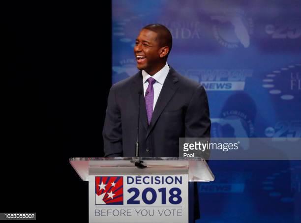Democrat Andrew Gillum laughs during his debate with Republican Ron DeSantis at Broward College October 24 2018 in Davie Florida The second and final...