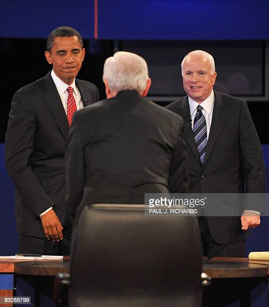 Democrat Barack Obama and Republican John McCain face CBS Correspondent and debate moderator Bob Schieffer at Hofstra University at the end of their...