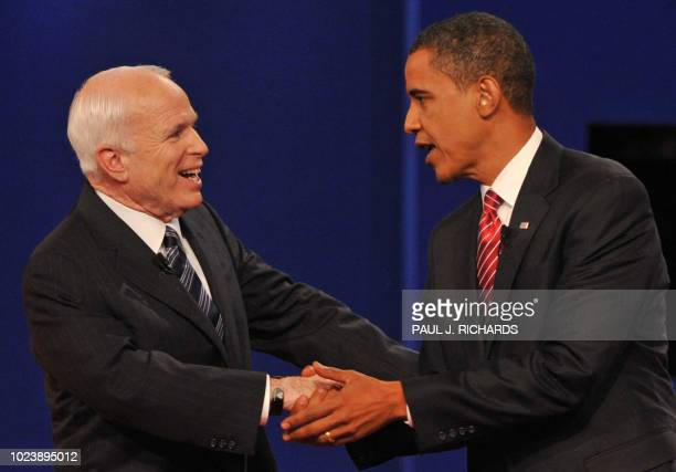 Democrat Barack Obama and Republican John McCain greet each other at Hofstra University at the end of their third and final presidential debate on...