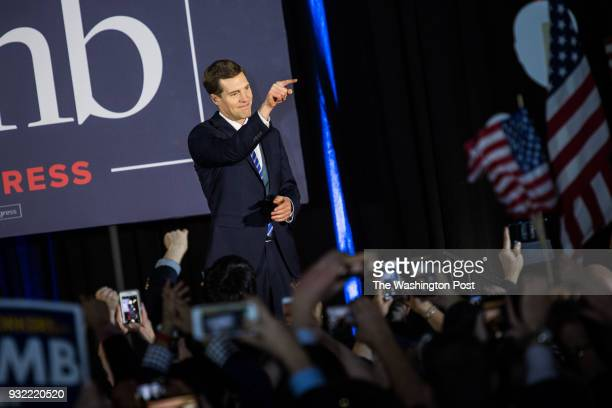 Democrat candidate Conor Lamb enters the stage and greet supporters before giving his victory speech at the Hilton Garden Inn PittsburghSouthpointe...