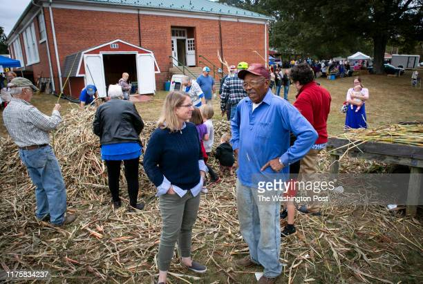 Democrat Christian Worth left talks with Jasper Fletcher as she meets with potential voters Saturday October 5 2019 at the Sorghum Festival in...