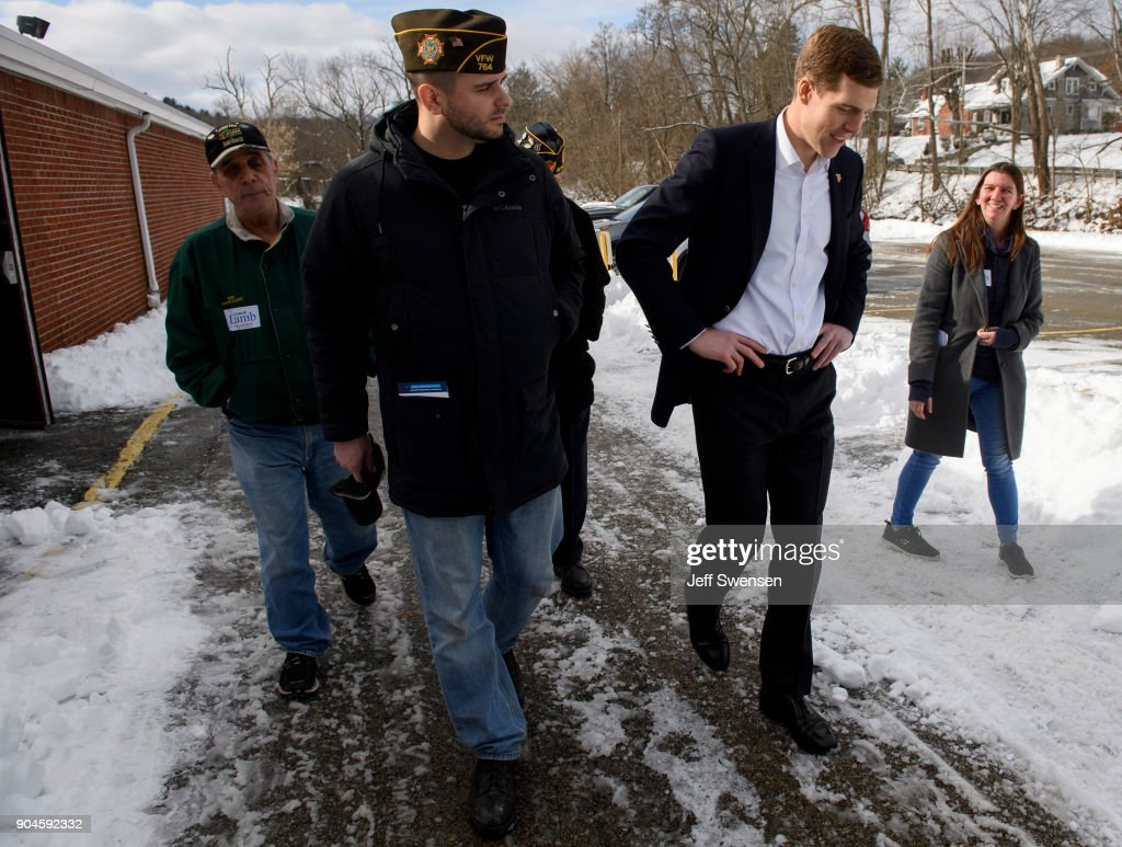 Democrat Conor Lamb, a former U.S. attorney and US Marine Corps veterans running to represent Pennsylvania's 18th congressional district, leaves the American Legion Post 902 after a rally on January 13, 2018 in Houston, Pennsylvania in the southwestern corner of the state. President Donald Trump plans to visit Pennsylvania's 18th Congressional District next week in a bid to help Lamb's republican opponent, Rick Saccone.