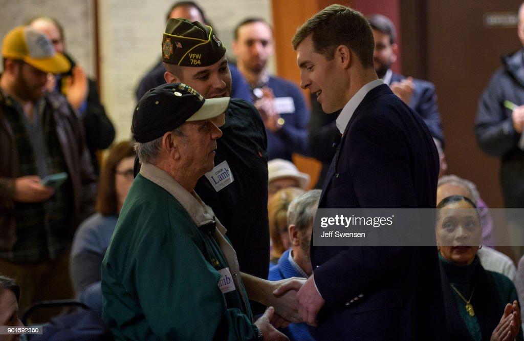 Democrat Conor Lamb, a former U.S. attorney and US Marine Corps veterans running to represent Pennsylvania's 18th congressional district, speaks to an audience at the American Legion Post 902 on January 13, 2018 in Houston, Pennsylvania in the southwestern corner of the state. President Donald Trump plans to visit Pennsylvania's 18th Congressional District next week in a bid to help Lamb's republican opponent, Rick Saccone.