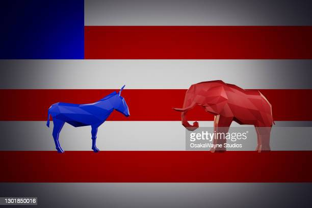 democrat donkey standing against republican elephant on american flag - presidential candidate stock pictures, royalty-free photos & images