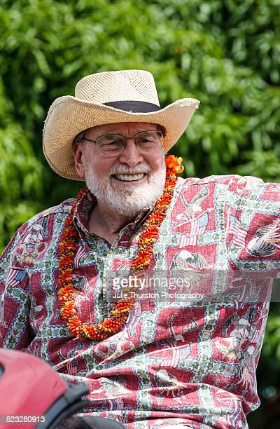 Democrat Hawaii Governor Neil Abercrombie Wearing an Aloha Shirt and Flower Lei Waves in a Parade in Kailua Hawaii on the Island of Oahu 2014 Former...