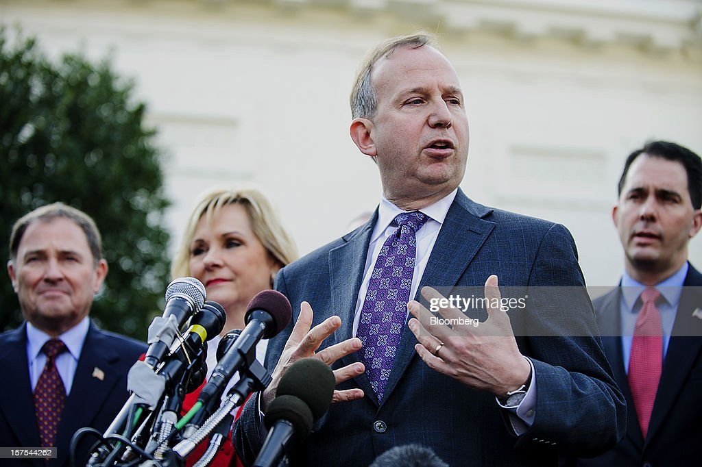 Democrat Jack Markell, governor of Delaware, second right, speaks while Republicans Gary Herbert, governor of Utah, left, Mary Fallin, governor of Oklahoma, second left, and Scott Walker, governor of Wisconsin, listen during a press conference after meeting with U.S. President Barack Obama in Washington, D.C., U.S., on Tuesday, Dec. 4, 2012. Negotiations over the so-called fiscal cliff are stalled as President Obama and Republicans trade offers on ways to avoid more than $600 billion in U.S. spending cuts and tax increases for 2013 that will start to take effect in January if Congress doesn't act. Photographer: Andrew Harrer/Bloomberg via Getty Images