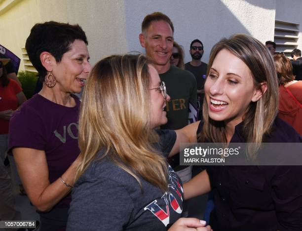 Democrat Katie Hill who is running for Congress in California's 25th District meets voters after a rally before the midterm elections in Santa...