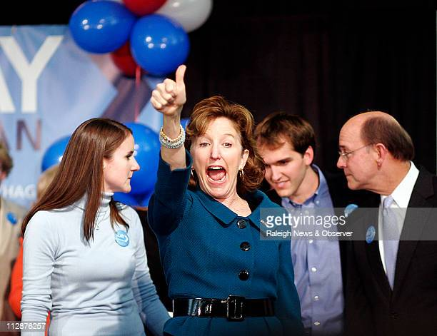 Democrat Kay Hagan standing in front of her family celebrates winning a US Senate seat for North Carolina in a race against Elizabeth Dole at the...