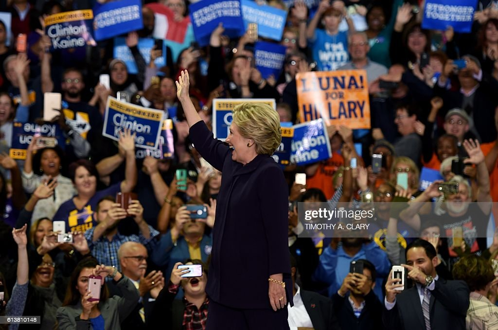 Democrat nominee Hillary Clinton arrives at a rally at Wayne State University in Detroit, Michigan October 10, 2016. / AFP / TIMOTHY