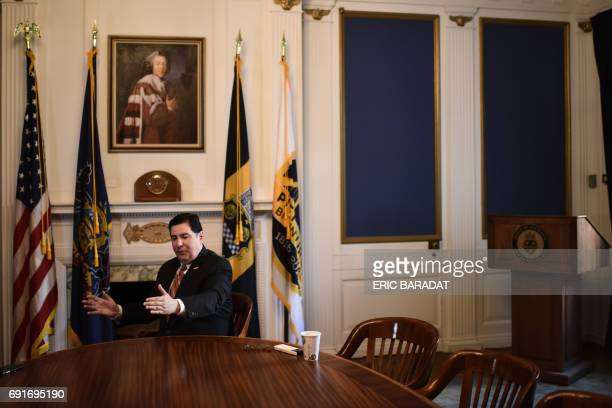 Democrat Pittsburgh Mayor Bill Peduto answers a journalist's questions at his office in Pittsburgh Pennsylvania on June 2 2017 As the people of...
