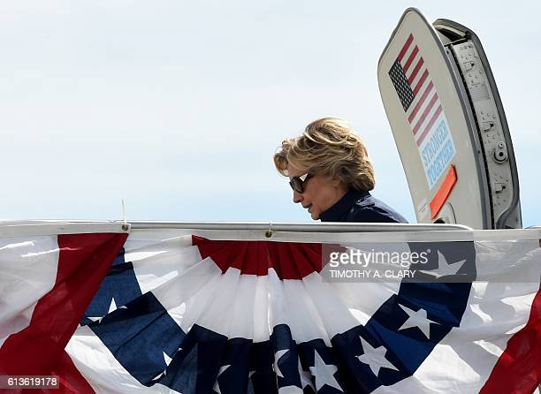 US Democrat presidential nominee Hillary Clinton arrives October 9 2016 at LambertSt Louis International Airport in St Louis Missouri where she will...
