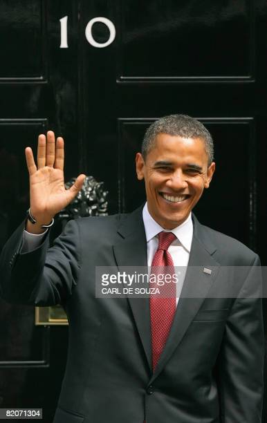 Democrat Senator Barack Obama smiles to the media on Downing Street following a meeting with British Prime Minister Gordon Brown on July 26 2008 The...
