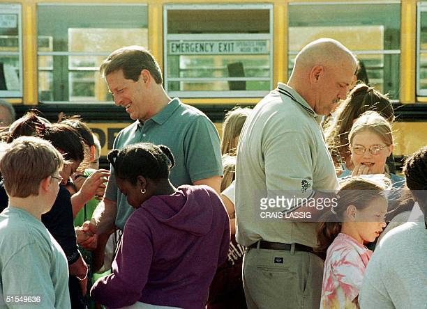 Democrati presidental candidate Vice President Al Gore and Minnesota Governor Jesse Ventura sign autographs and mingle with students arriving at...