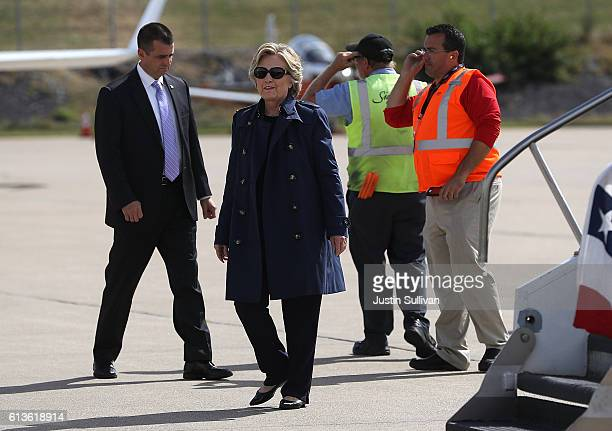 Democrati presidential nominee former Secretary of State Hillary Clinton arrives at LambertSt Louis International Airport on October 9 2016 in St...