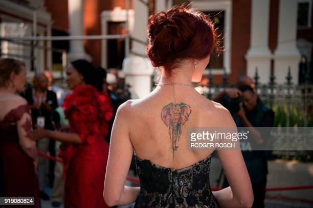 Democratic Alliance Member of Parliament Terri Stander poses with her tattoo depicting an elephant on her back as she arrives to attend the State of...