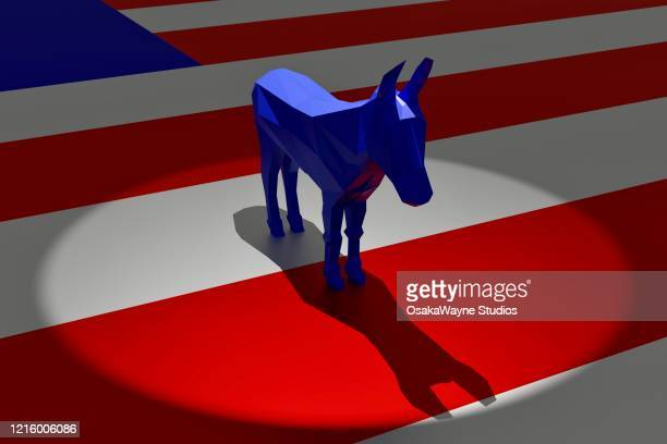 democratic blue donkey in spotlight on top of american flag - symbol stock pictures, royalty-free photos & images